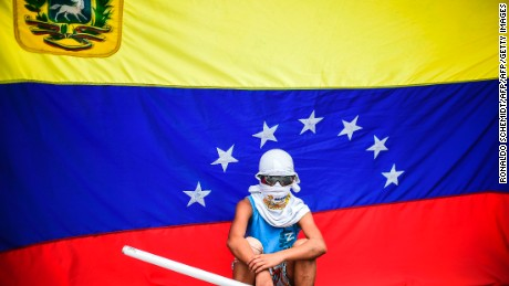 TOPSHOT - An opposition activist stands by during a protest against the newly inaugurated Constituent Assembly in Caracas on August 4, 2017. Venezuelan President Nicolas Maduro installed a powerful new assembly packed with his allies, dismissing an international outcry and opposition protests saying he is burying democracy in his crisis-hit country. / AFP PHOTO / RONALDO SCHEMIDT        (Photo credit should read RONALDO SCHEMIDT/AFP/Getty Images)