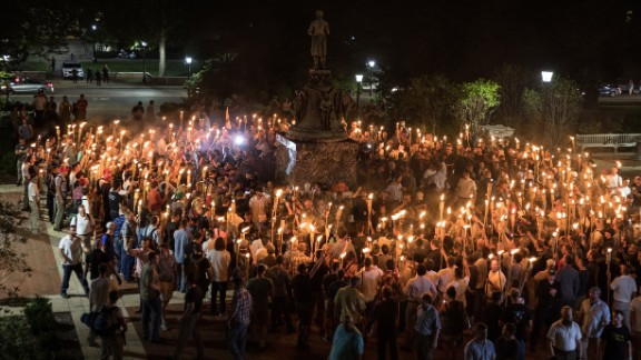 White nationalists carrying torches surround protesters Friday night at the foot of a statue of Thomas Jefferson on the University of Virginia