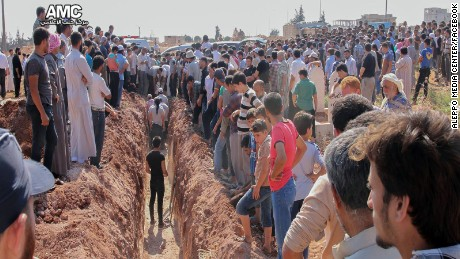 People gather Saturday for the funeral of slain members of the Syrian Civil Defense in Idib province.