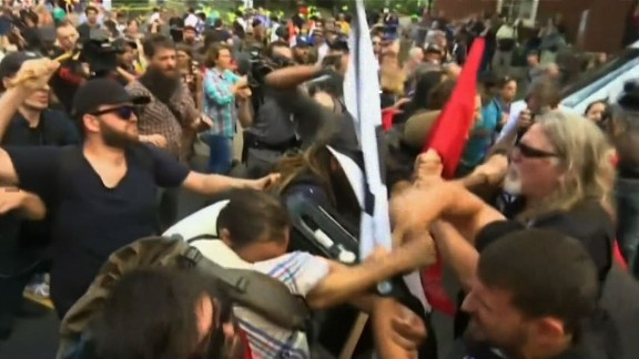 Demonstrators clash late Saturday morning in Charlottesville, Virginia.