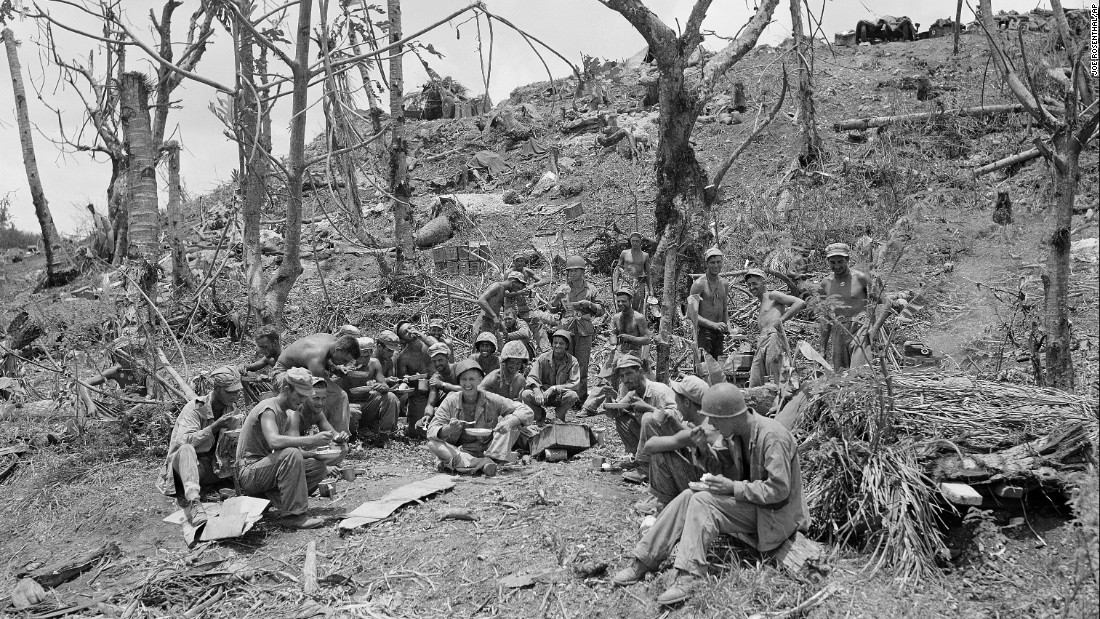 US troops stop to eat on the road to Agana, the capital of Guam, August 10, 1944. The United States took control of Guam after the Second Battle of Guam and turned the island into an important strategic foothold in the Pacific theater.