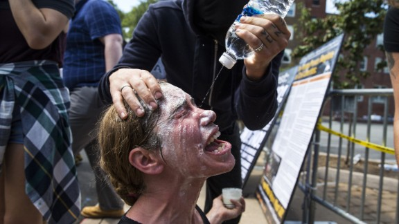 A woman is treated for exposure to pepper spray during clashes between white nationalists and counterprotesters at Emancipation Park.