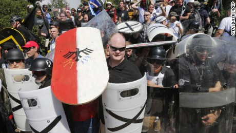 White nationalist demonstrators use shields as they guard the entrance to Lee Park in Charlottesville, Virginia, Saturday, August 12, 2017.