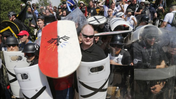 White nationalists use shields as they guard the entrance to Emancipation Park.
