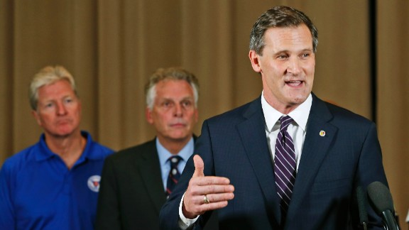 Charlottesville Mayor Mike Signer, right, gestures during a news conference concerning the white nationalist rally and violence as Virginia Gov. Terry McAuliffe, center, and Virginia Secretary of Public safety Brian Moran, left, listen in Charlottesville, Virginia, Saturday, August 12, 2017.