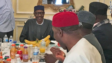 A photo released by the Nigeria State House on July 23 shows President Muhammadu Buhari, back center, during a meeting with Nigeria ruling party's governors in London.