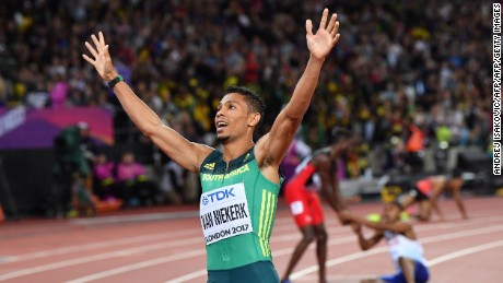 South Africa's Wayde Van Niekerk celebrates after winning second place in the final of the men's 200m athletics event at the 2017 IAAF World Championships at the London Stadium in London on August 10, 2017. / AFP PHOTO / Andrej ISAKOVIC        (Photo credit should read ANDREJ ISAKOVIC/AFP/Getty Images)