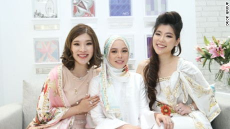 Yusof (center) wears one of her creations.