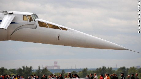 People standing near a Russian Tu-144 watch fighter jets perfoming tricks during the MAKS 2009 international aerospace show outside Moscow in Zhukovsky on August 20, 2009. The MAKS international aerospace show is being held for the 9th time.            AFP PHOTO / DMITRY KOSTYUKOV (Photo credit should read DMITRY KOSTYUKOV/AFP/Getty Images)