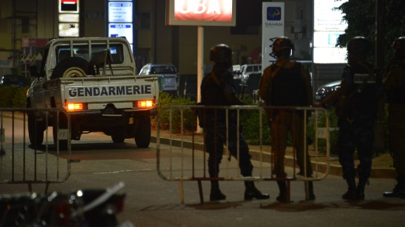 Burkina Faso police and army forces patrol the steets on August 13, 2017 after gunmen attacked a cafe in the capital.