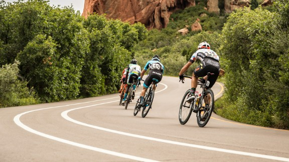 The winding route, the racers say, is hard but fun. At the top of the mountain, it winds past red moon rock formations jutting into the sky like hands of an ancient giant.