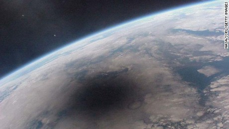 A view of the Earth during a solar eclipse. The shadow of the Moon can be seen darkening part of Earth. This shadow moves across the Earth at nearly 2,000 kilometers per hour. Only observers near the center of the dark circle see a total solar eclipse - others see a partial eclipse where only part of the Sun appears blocked by the Moon. This picture of the Aug. 11, 1999 solar eclipse was one of the last ever taken from the Mir space station. Mir was decommissioned after more than ten years of use.