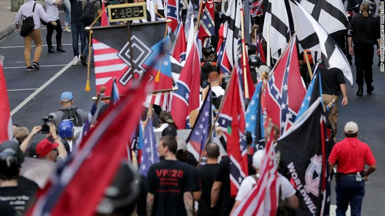 """Hundreds of white nationalists, neo-Nazis and members of the """"alt-right"""" march during the """"Unite the Right"""" rally August 12, 2017/"""