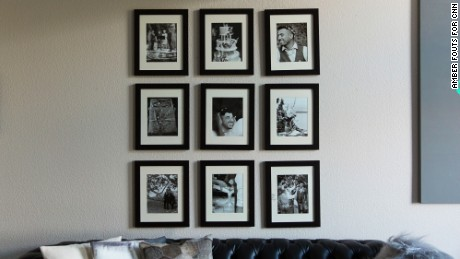 Wedding photos decorate a wall in their living room in Seattle.