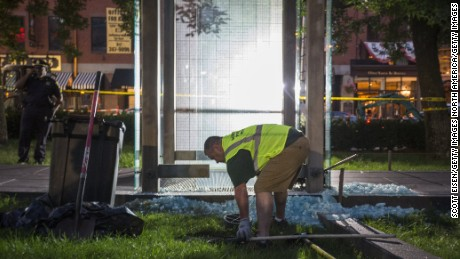 BOSTON, MA - AUGUST 14:  A worker cleans up broken glass at the New England Holocaust Memorial that was vandalized when a rock was thrown through a panel that was part of it on August 14, 2017 in Boston, Massachusetts.  (Photo by Scott Eisen/Getty Images)