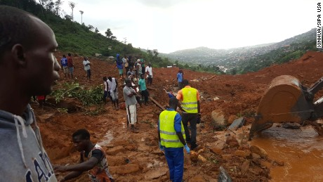 Rescue workers gather at the summit of a mudslide in Regent, east of Freetown, on Monday.