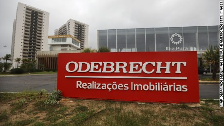 RIO DE JANEIRO, BRAZIL - APRIL 12:  An Odebrecht sign is displayed in front of the now abandoned Rio 2016 Olympic Games athletes village on April 12, 2017 in Rio de Janeiro, Brazil. A plea bargain by Odebrecht employees in the Lava Jato (Car Wash) corruption scandal has led to testimony ensnaring nine ministers in President Michel Temer's cabinet under investigation as the political crisis in the country deepens.  (Photo by Mario Tama/Getty Images)