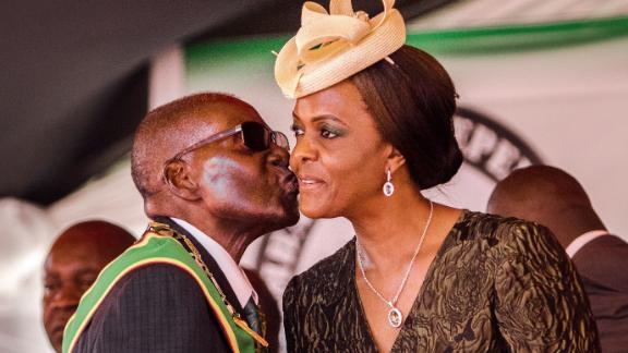President Robert Mugabe kisses first lady Grace Mugabe during Zimbabwe's 37th Independence Day celebrations in April.