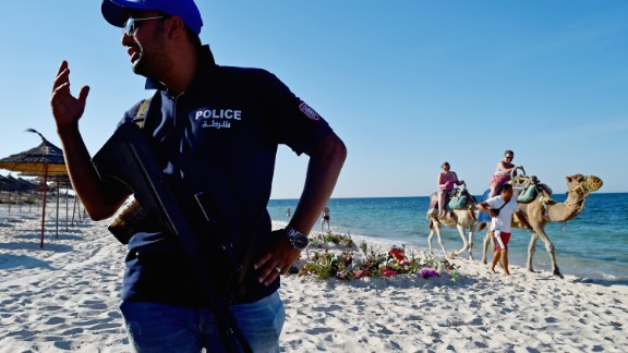 Armed police patrol Marhaba beach in Sousse in the aftermath of an ISIS attack that killed 38 people.
