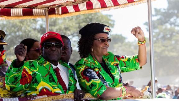Zimbabwe President Robert Mugabe (L) with his wife Grace Mugabe at a youth rally on June 2, 2017.