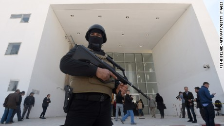 A member of the Tunisian security forces stands guard at the National Bardo Museum in Tunis after an attack on foreign tourists. Security has been bolstered at tourist sites across the country.