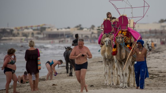 Tourists on a beach in Sousse a year after the attacks. Recent statistics show a recovery of visitor numbers.