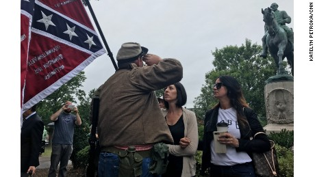 Man in Confederate uniform confronted by Charlottesville residents