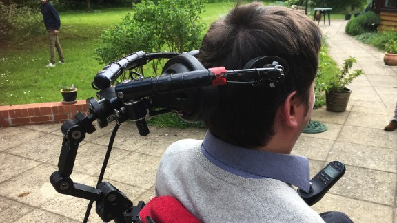 Tom Nabarro uses a head control to move his wheelchair.