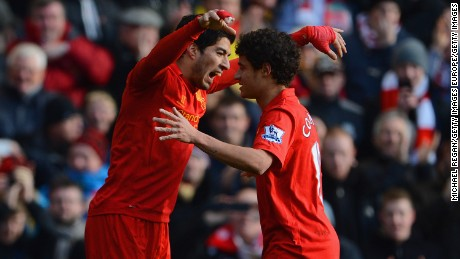 Luis Suarez and Philippe Coutinho are pictured playing together for Liverpool in 2013.