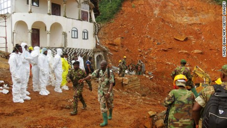 A search-and-rescue team and soldiers operate at the disaster site this week in Freetown.