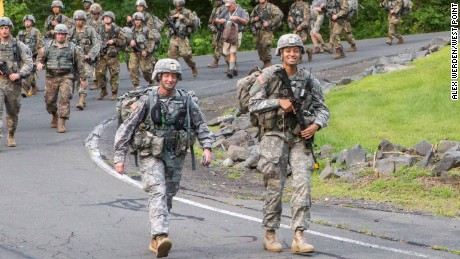 Askew leads West Point Corps of Cadets members as the march back from Camp Buckner to complete basic training.