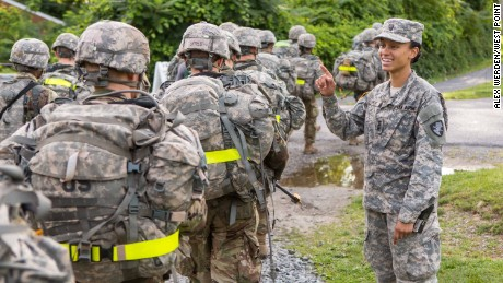 Cadet Simone Askew -- the first African-American woman to be First Captain of West  Point's Corps of Cadets -- cheers on members of the Class of 2021 at a checkpoint.