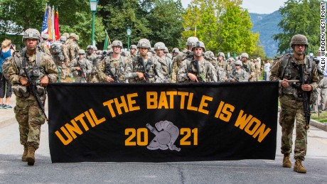Askew is front and center as she leads members of the Cadet Basic Training Regiment as they march from Camp Buckner.