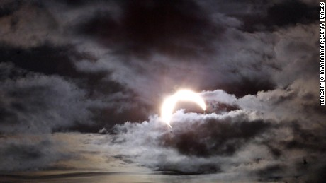 A solar eclipse is partially obscured by clouds December 14,  2001 in Puntarenas, Costa Rica.
