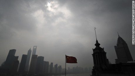 Heavy clouds cover the sun during the longest solar eclipse of the 21st century, in Shanghai on July 22, 2009.