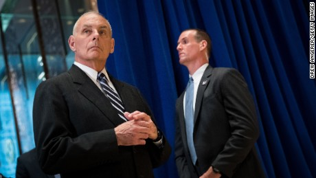 White House Chief of Staff Gen. John Kelly, left, looks on as President Donald Trump speaks following a meeting on infrastructure at Trump Tower on Tuesday in New York. Trump fielded questions from reporters about his comments on the events in Charlottesville, Virginia, and white supremacists.