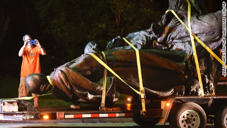 A monument dedicated to Maryland's Confederate women gets taken down early Wednesday.