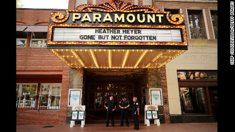 Police officers stand watch Wednesday at the Paramount Theater in Charlottesville.