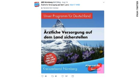The post calls for medical provision to be guaranteed in rural areas in Germany, but it features a picture of a Swiss mountain.