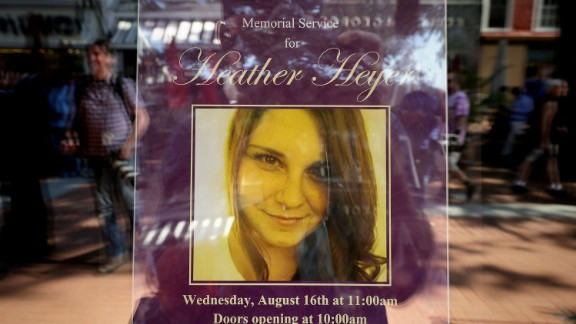 A poster announcing the memorial service for Heather Heyer, who was killed when a car slammed into a crowd of people protesting against a white supremacist rally, stands in the window of the Paramount Theater August 16, 2017 in Charlottesville, Virginia. Charlottesville will hold a memorial service for Heyer Wednesday, four days after she was killed when a participant in a white nationalist, neo-Nazi rally allegedly drove his car into the crowd of people demonstrating against the