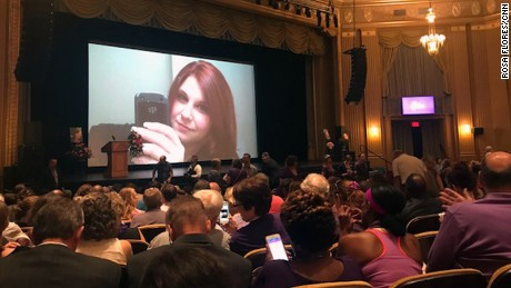 A slideshow of photos of Heather Heyer was shown as people took their seats in the Paramount Theater in Charlottesville.