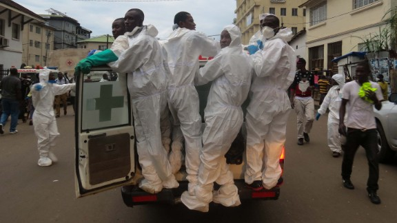 Members of a burial team head out from the Freetown morgue.