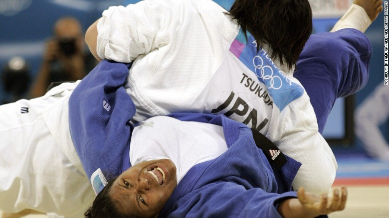 Maki Tsukada of Japan pins Dayma Beltran of Cuba for ippon during their gold medal match at the 2004 Athens Olympics.