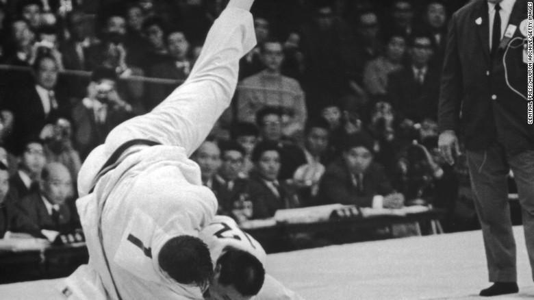 Japanese wrestler Isao Inokuma beats Canada's Alfred Douglas Rogers in the Judo Heavyweight final at the Tokyo Olympics, 1964.