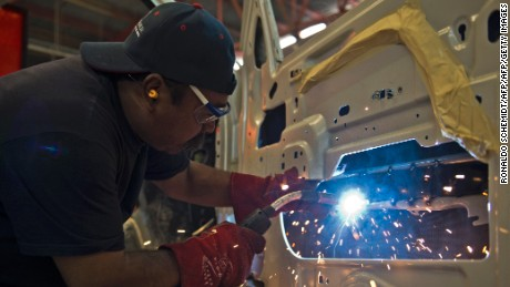 An employee puts armor plates on a car in Ecatepec, Mexico on September 27, 2012. The demand for armored cars is increasing in Mexico according to the Mexican Association of Armored Cars. AFP PHOTO/RONALDO SCHEMIDT / AFP / Ronaldo Schemidt        (Photo credit should read RONALDO SCHEMIDT/AFP/Getty Images)
