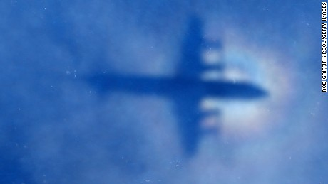 PERTH, AUSTRALIA - MARCH 31:  A shadow of a Royal New Zealand Air Force P3 Orion aircraft is seen on low cloud cover while it searches for missing Malaysia Airlines Flight MH370 on March 31, 2014 in Perth, Australia. Several objects have been sighted in the Indian Ocean over the past few days, but none confirmed to be related to the missing airliner. The Malaysian airlines flight disappeared on March 8 with 239 passengers and crew on board and is suspected to have crashed into the southern Indian Ocean.  (Photo by Rob Griffith/Pool/Getty Images)