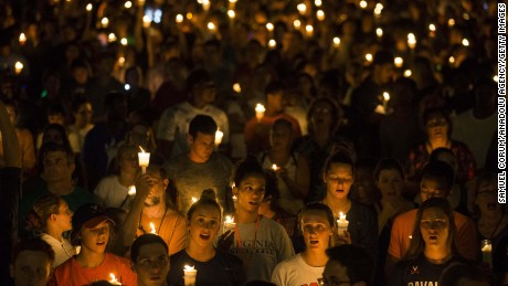 CHARLOTTESVILLE, USA - AUGUST 16: Thousands gather with candles to march along the path that White Supremacists took the prior Friday with torches on the University of Virginia Campus in Charlottesville, United States on August 16, 2017. (Photo by Samuel Corum/Anadolu Agency/Getty Images)