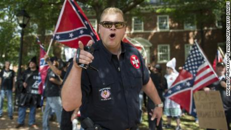 TOPSHOT - A member of the Ku Klux Klan shouts at counter protesters during a rally, calling for the protection of Southern Confederate monuments, in Charlottesville, Virginia on July 8, 2017. The afternoon rally in this quiet university town has been authorized by officials in Virginia and stirred heated debate in America, where critics say the far right has been energized by Donald Trump's election to the presidency.  / AFP PHOTO / ANDREW CABALLERO-REYNOLDS        (Photo credit should read ANDREW CABALLERO-REYNOLDS/AFP/Getty Images)