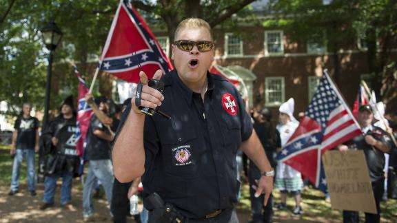 """Was it """"ethno-nationalism,""""  """"racial anxiety"""" or just plain racism that motivated demonstrators like this man at the Charlottesville protests in 2017? The words we use matter, some say."""