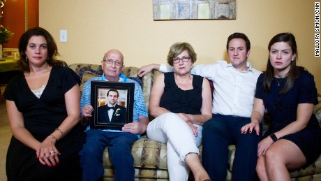 The Jabara family sits with a photo of Khalid. From left: Victoria, Mounha, Haifa, Rami, and his wife, Jenna.